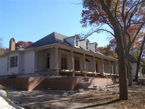 acadian house plans  story raised acadian house plans  front porches elevated house