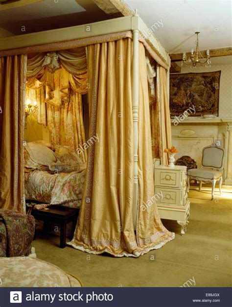 Four Poster Drapes - opulent silk drapes on four poster bed in countgry