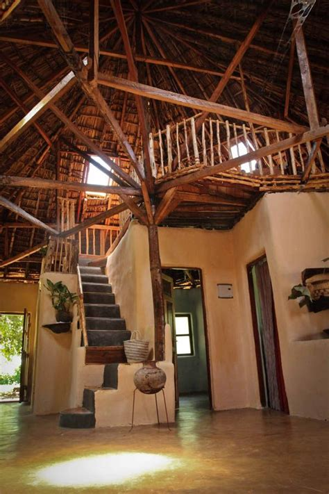 friends built  house   local trees mud   dung traditional kenyan