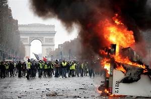 Paris riots: Police fire tear gas and water cannons to ...
