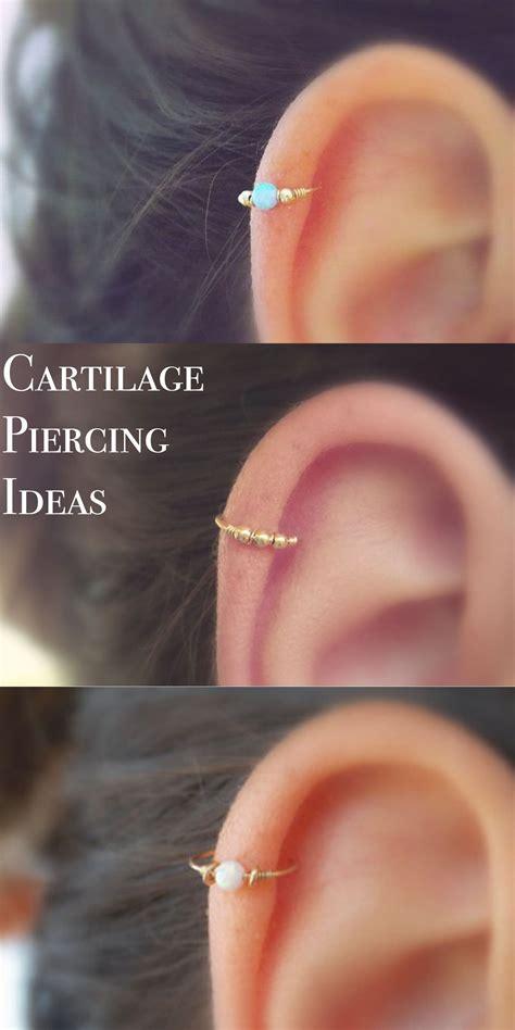 andromeda opal ring ear piercing   jewelry