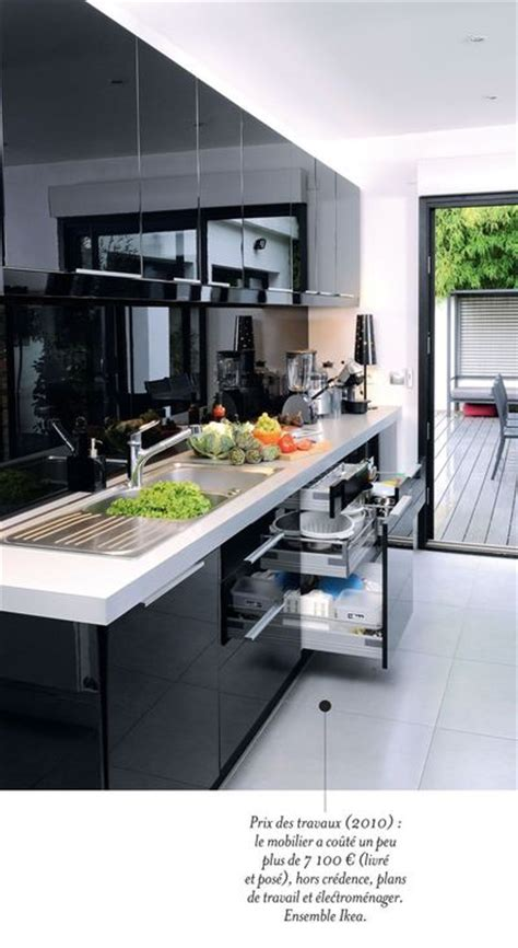 cuisine contemporaine avec ilot central une cuisine contemporaine avec îlot central côté maison