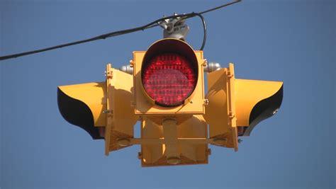 4 way stoplight blue sky background stock