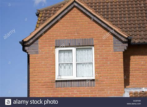 Gable End Of Red Brick House Showing Corbelling And