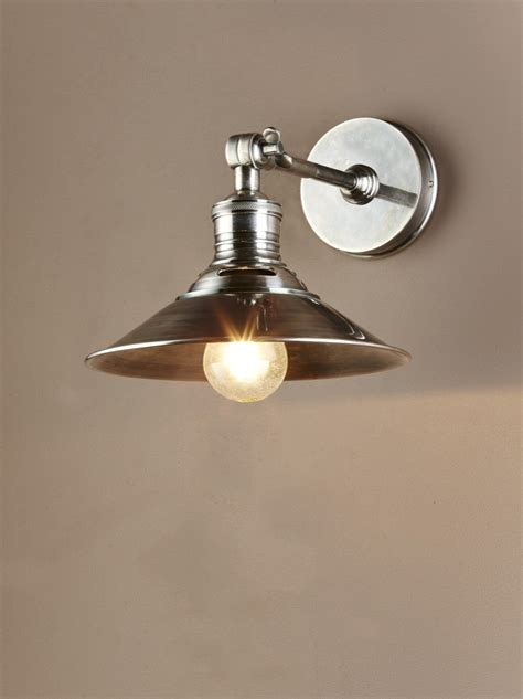 rowland wall sconce in antique silver christophe living