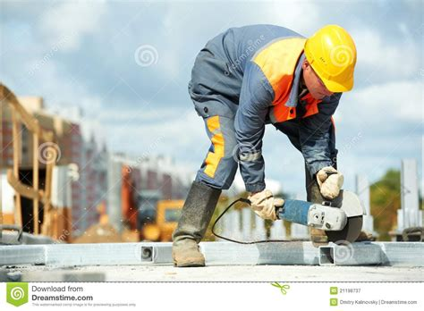 Builder Free by Builder Working With Cutting Grinder Royalty Free Stock