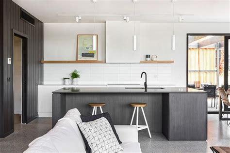 warm color accents adding interest  black  white interior design  minimalist style