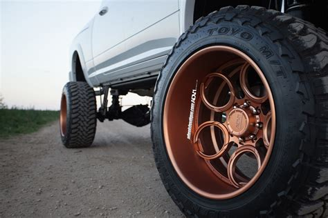 lifted ram   rose gold wheels meets  horse