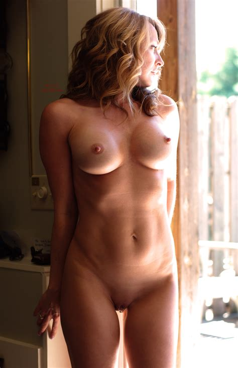 Redhead Standing Nude With Large Boobs And Erected Nipples By Glass Door The Free Voyeurclouds