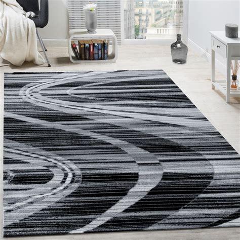 edler designer teppich geschwungene linien kurzflor grau