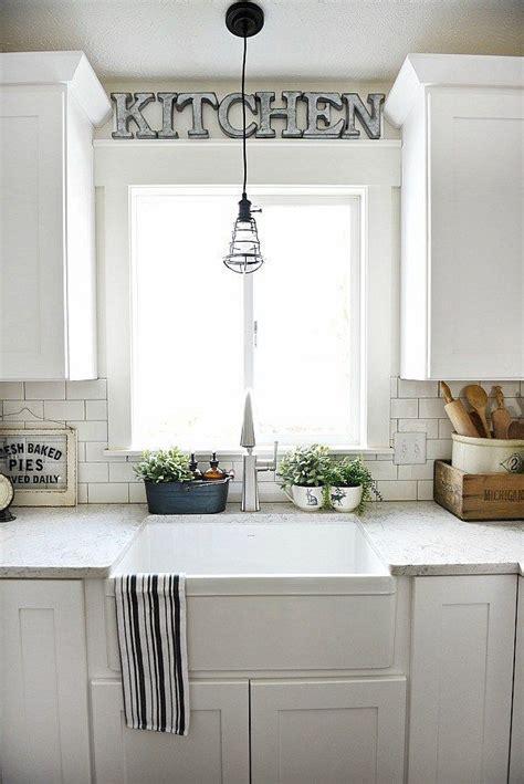 ideas  kitchen sink lighting  pinterest