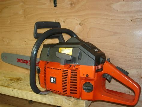 Husqvarna 61 Chainsaw With New 18 Bar Chain Runs Excellent