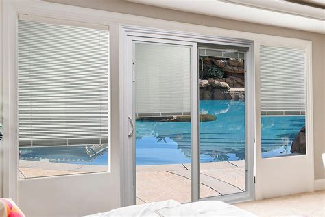 patio doors with blinds between the glass small storage