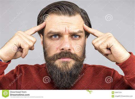 Closeup Of Young Man Thinking Hard Stock Photo
