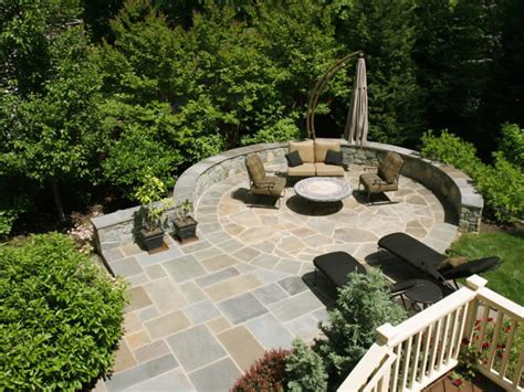 Flagstone Patio Designs by Circular Flagstone Patio On Steeply Sloped Backyard