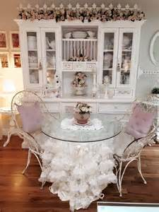 lovely shabby chic dining room with white hutch and a