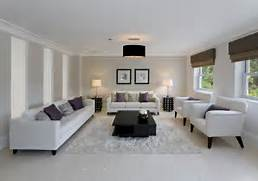 All White Living Room Adds High Contrast Via Central Two Tier Jet Of Beautiful Living Room Carpet That You Can Apply To The Living Room White Living Room Inspiring Wonderful Black And White Contemporary Living Room White Modern Living Room Furniture Medium Limestone Wall