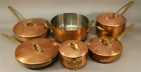 group   castle copper cookware pans mid  late  century comprising  shallow li