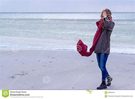 Lone Sad Beautiful Girl Walking Along The Shore Of The