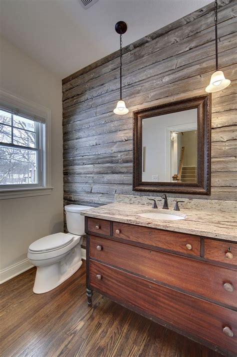 plank wall bathroom powder room with barn wood accent wall vanity from antique mahogany dresser designed and built