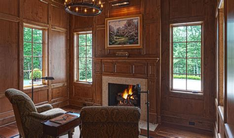 gorgeous wood paneled study  fireplace