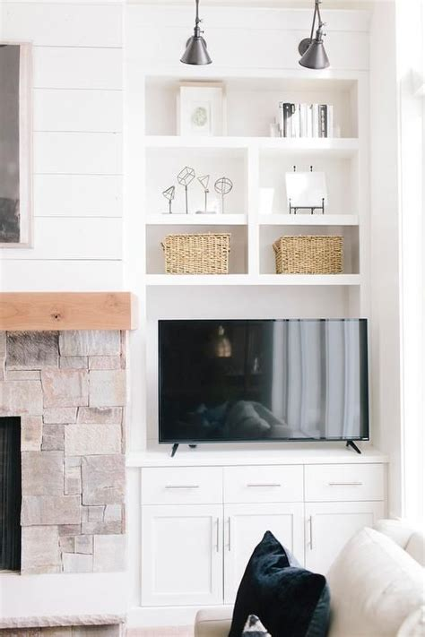 cabinets next to fireplace bm simply white chic cottage living room features a stone