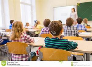 Group Of School Kids And Teacher In Classroom Stock Photo ...