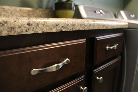 hardware for dark kitchen cabinets handles on cabinet drawers and knobs on cabinet doors