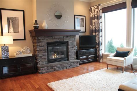 40860 modern grey fireplace neutral living room with gray stacked fireplace hgtv