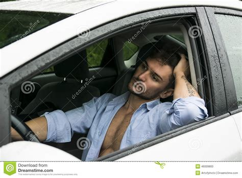 Tired Gorgeous Man Driving His Car Stock Photo