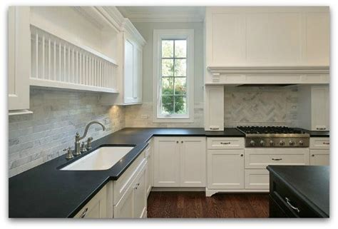 black countertops with white cabinets absolute black