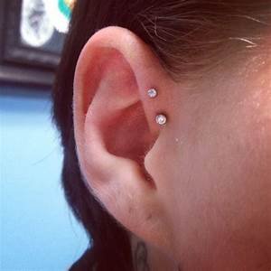 Double Forward Helix Piercing done by Aaron Victory at The ...