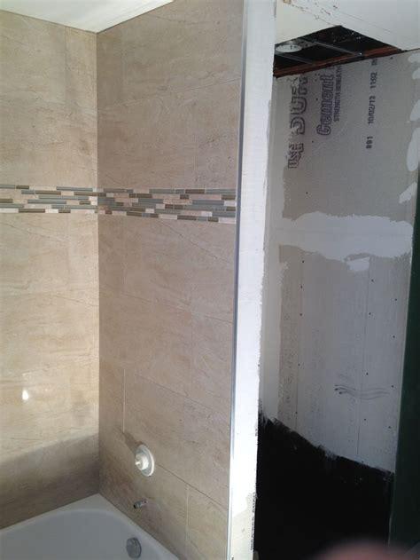 12x24 tile tub surround a tub surround we installed 12x24 porcelain tile on a