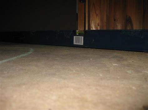 new basement tile floor uneven and wavy ceramic
