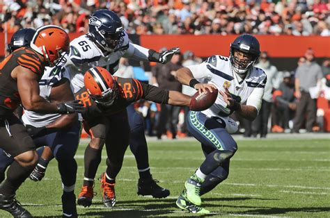 seahawks improve     russell wilson guides comeback
