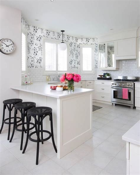 black and white photos with accents black and white kitchen with pink accents transitional kitchen