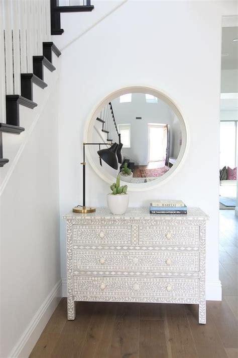 greek key foyer chest  gilt mirror transitional