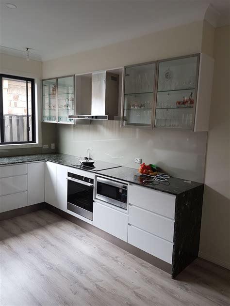 white kitchen  black granite tops custom kitchens