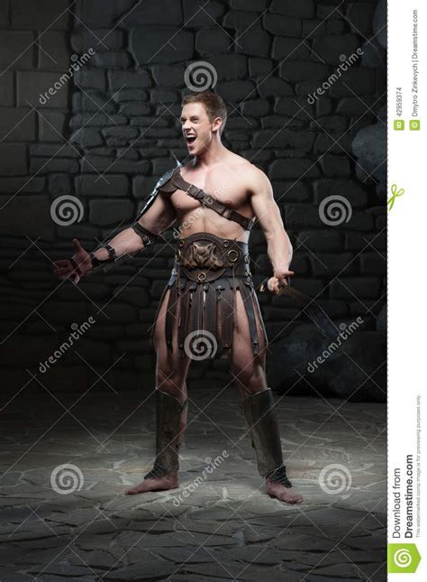 Gladiator With Sword Posing Stock Photo - Image of fighter ...