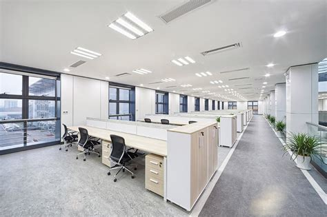 empty cubicles in a modern office building by office air conditioning installations free site survey
