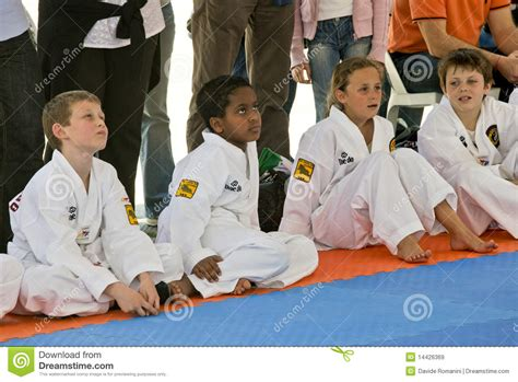 Sitting On The Mat - multiracial children sitting on the mat editorial stock