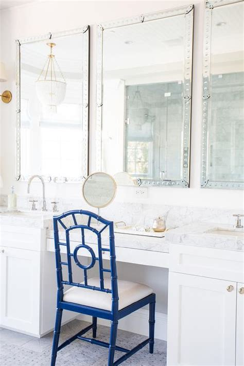 makeup vanity  blue chair transitional bathroom