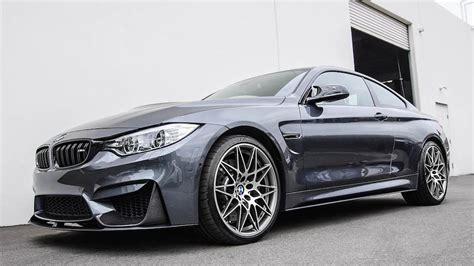 black maserati sports car spotlight bmw m4 competition package
