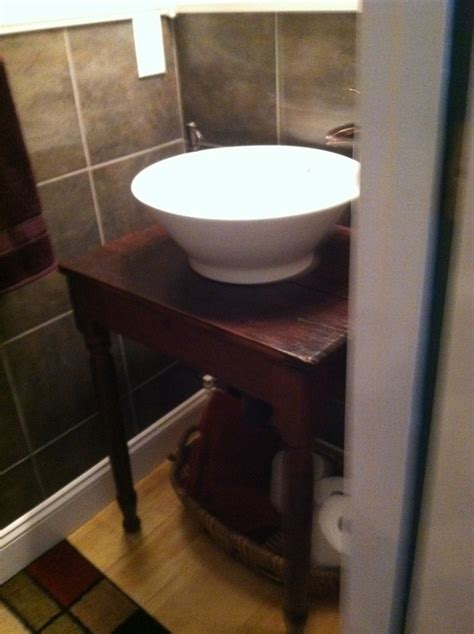 table converted to stand for vessel sink basket