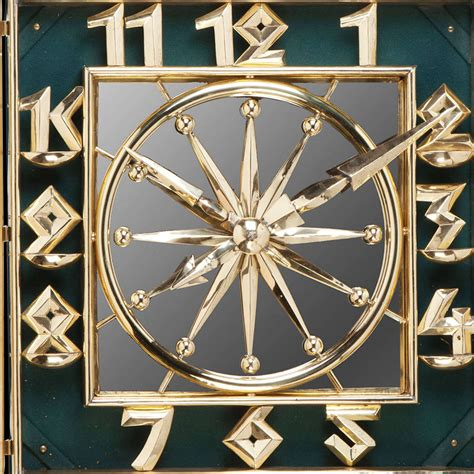 deco brass and mirrored wall clock at 1stdibs