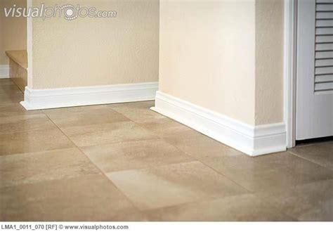 white baseboard along ceramic tile floor baseboard