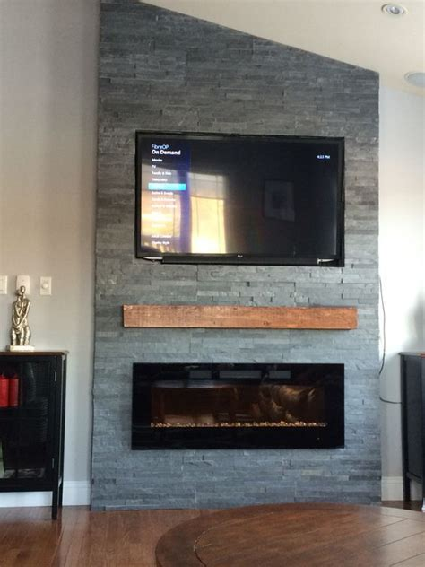grey stone fireplace  floating mantle electric