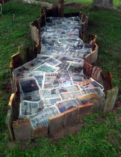 reclaimed wood garden bed lined  newspapers fluid