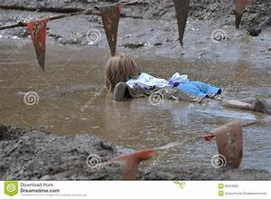 Girl In Mud Editorial Photo - Image: 20372026