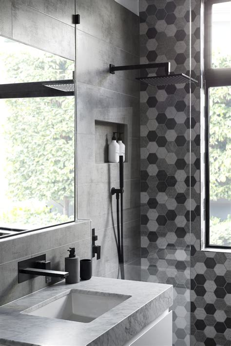 grey black white bathroom matte black accents add sophistication to this grey and white bathroom contemporist